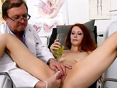 Redhead doctor widely opened and cum shot