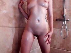 Teen having a shower and pruning in a solo vid