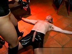 Ultra-kinky bitch dressed in horny latex and gives this dick a hand-job