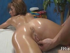 Naked honey decorated in massage lubricant getting puss fingerblasted